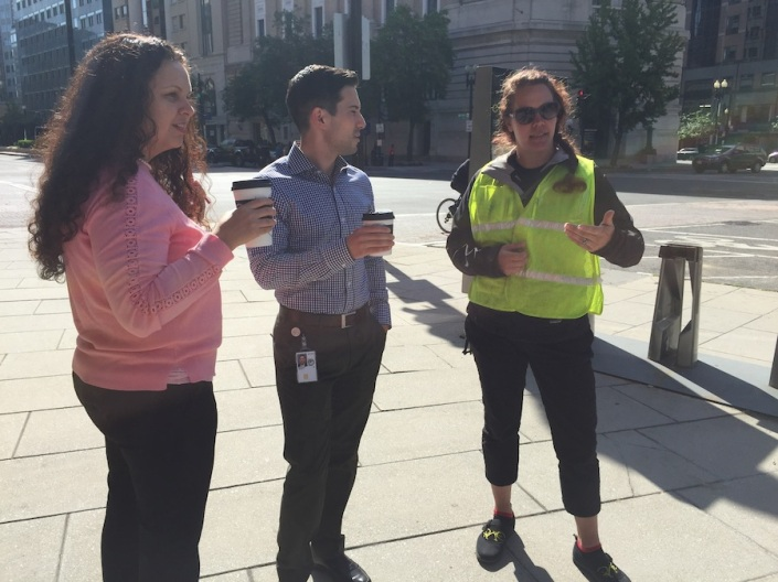 Kim Reynolds (right) explains Capital Bikeshare to two potential customers